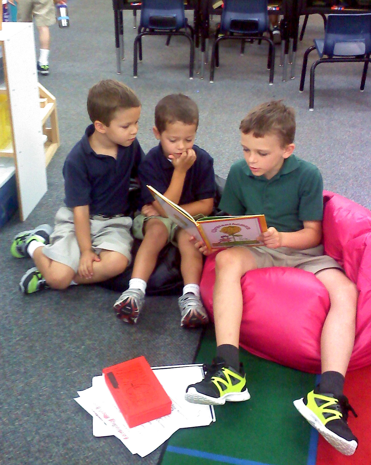 5th grader with his kindergarten reading buddies.